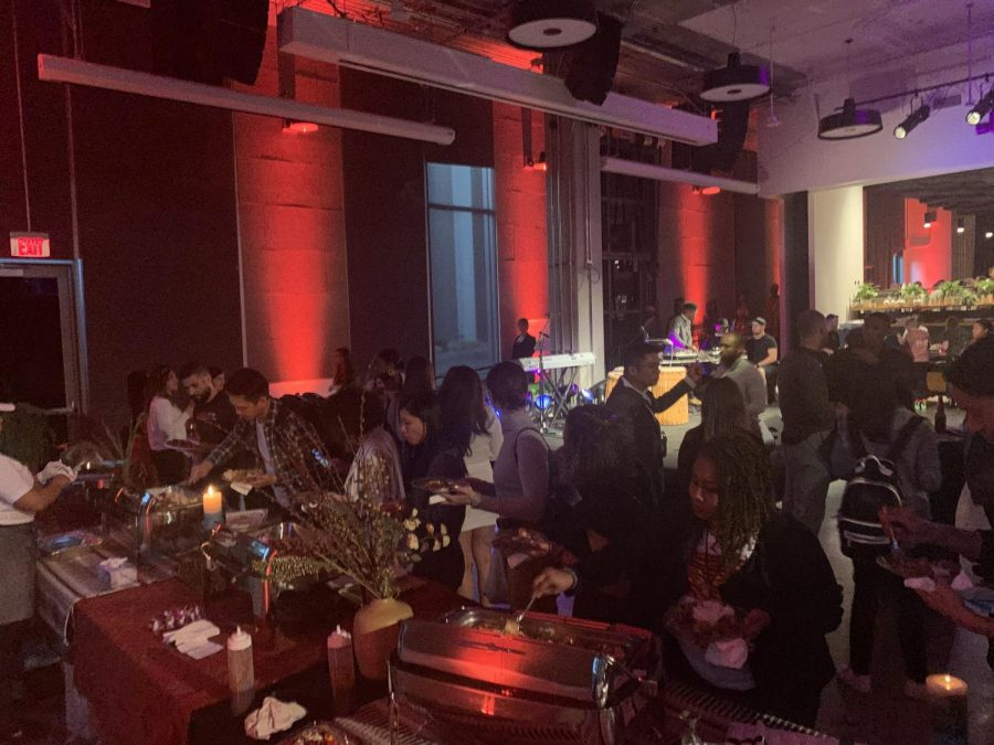 Attendees+of+a+Black+History+Month+celebration+at+Netflix+in+Los+Angeles+enjoy+a+spread+of+Cali-Caribbean+and+Soul+food.