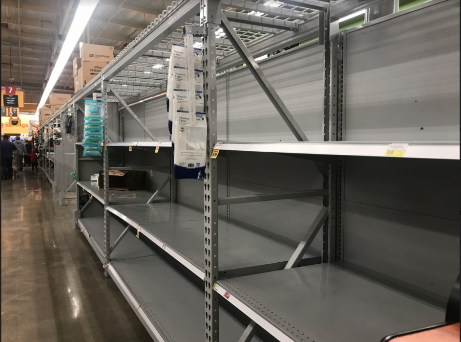 Shelves remain empty for hours at many stores in South Los Angeles. (Catherine Valdez/UT)