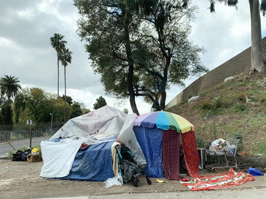 Homeless+take+shelter+under+tents+near+a+freeway+exit+in+Boyle+Heights.