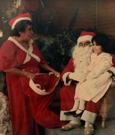 Bobby Lee Verdugo is shown dressed as Santa Claus for his family.