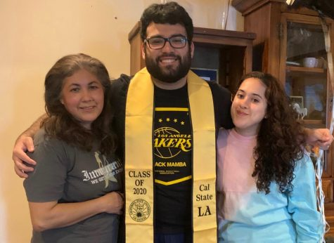 Darwin Lopez is pictured with his mother and sister.