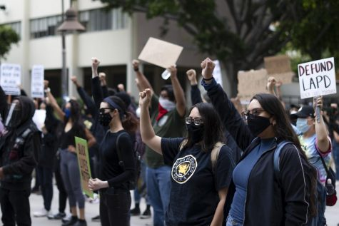 As people gathered at King Hall and prepared to march around campus in solidarity with the ongoing Black Lives Matter movement, they raised their fists in support of the protest that have been going on worldwide for the past two weeks. Photo by Joshua Mejia