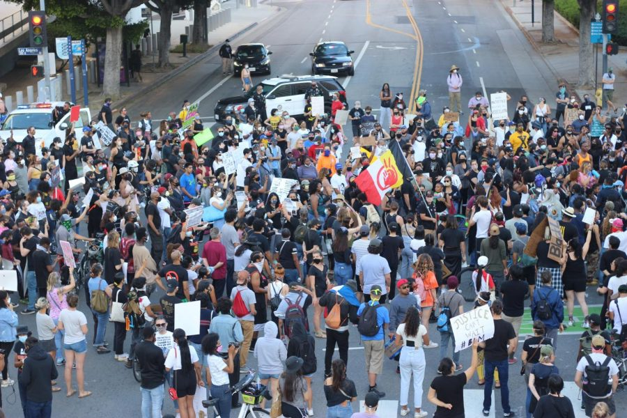 Protestors march in Downtown Los Angeles in support of the Black Lives Matter movement against police brutality. The recent protests were sparked from George Floyd's death in Minneapolis, Minnesota where we died due to a police officer pinning him down to the ground with his knee on his neck for close to nine minuets. Photo courtesy of Corinne Baptiste.