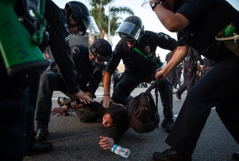 LAPD officers arrest a protester during a demonstration against the killing of George Floyd in police custody. The protest happened in the La Brea district of Los Angeles, California, on May 30, 2020.