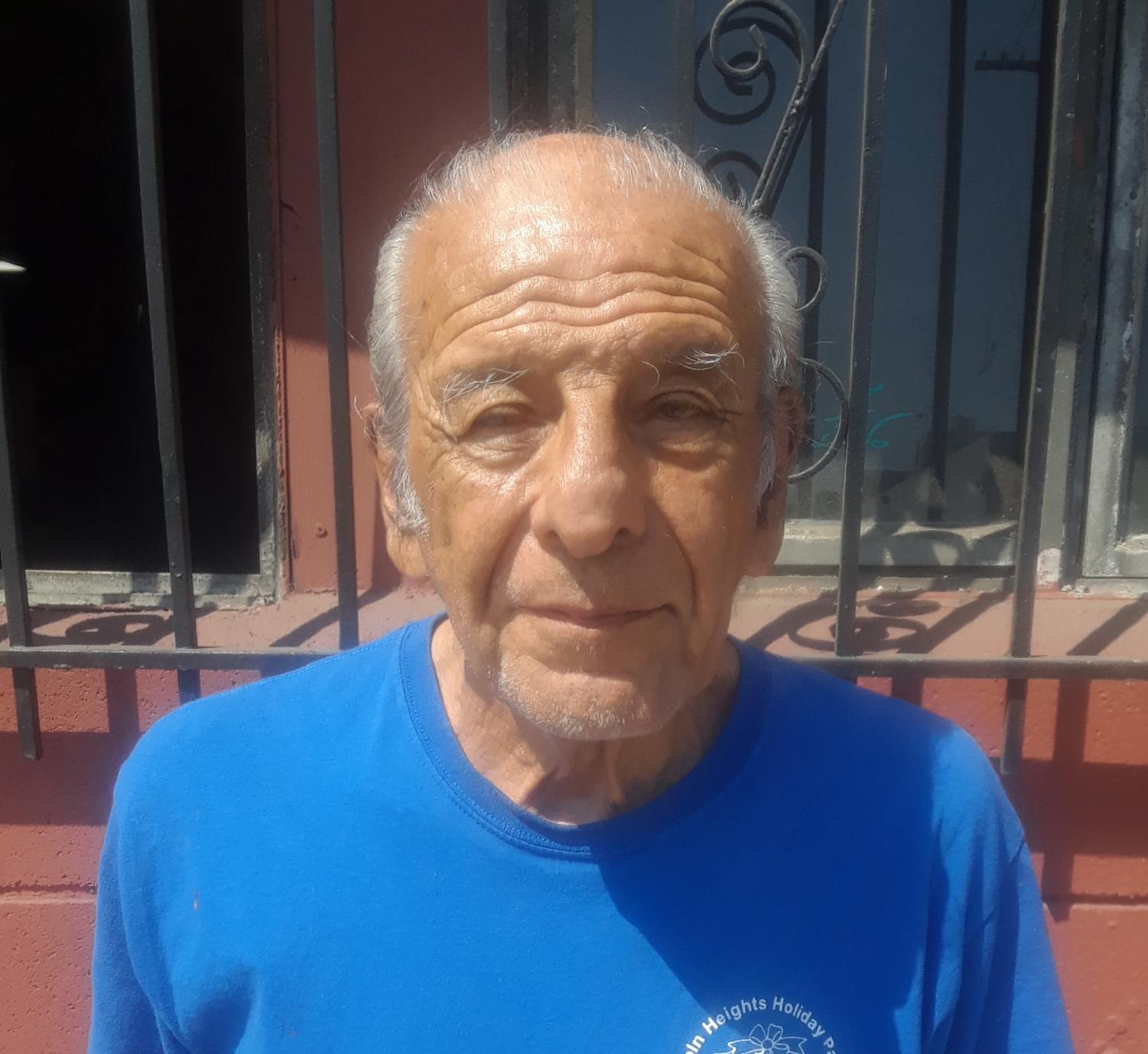 Photo of Gilbert Arevalo wearing a blue t-shirt and it is courtesy of Gilbert Arevalo.