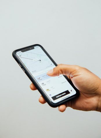 Photo of Rideshare app by Charles Deluvio courtesy of Unsplash
