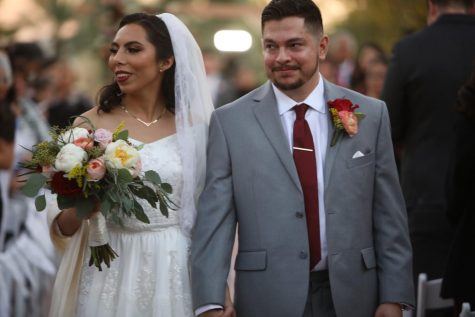 """Marisa Martinez (left) and Daniel Martinez (right) walking up the aisle after saying their """"I do"""