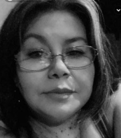 Headshot in black and white of Andrea Rivas wearing glasses.