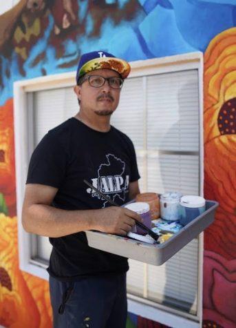 Juan in the process of painting his Vanessa Guillen mural. Photo courtesy of Juan Solis.