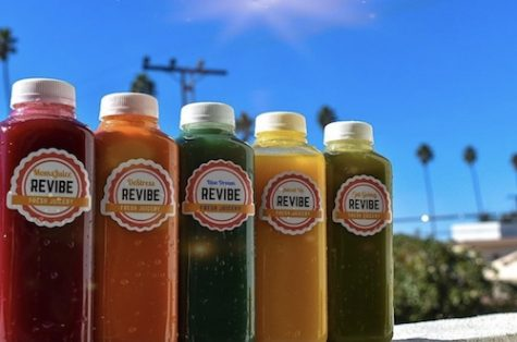 Juices of different colors lined up.