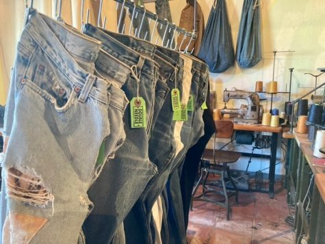 Jeans hang on a rack inside Double-Needle Repair  PC: Jared Everette