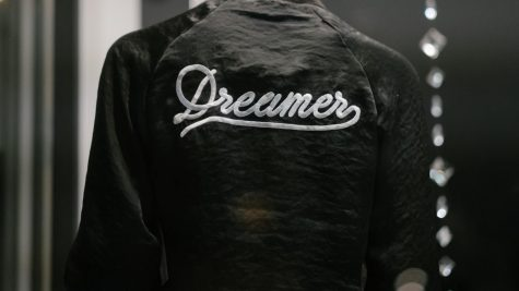 Black jacket that says the word dreamer.