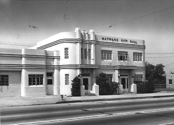 a black and white photo of a white Art Deco style building