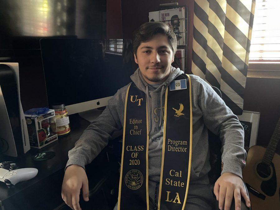 portrait of a guy wearing his graduation sash