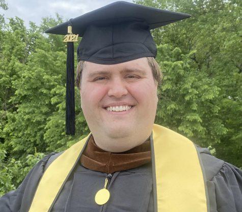 portrait of man with graduation attire