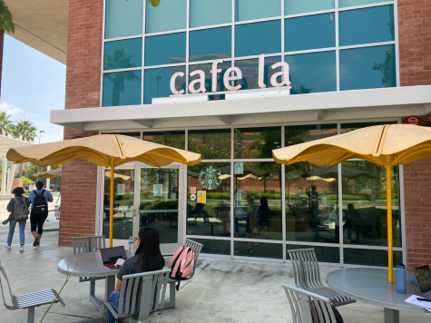 Photo shows the front of cafe la. Students can be seen outside the location.