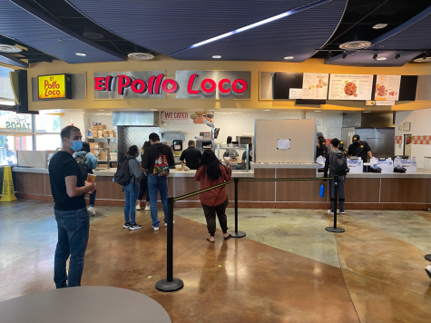 Photo shows people in line for the El Pollo Loco location on campus.