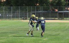 Football players run through a play during practice at Rivera Park (Eileen Osuna_UT)