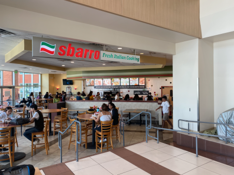 Photo shows people eating at the Sbarro location on campus