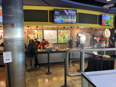 Photo shows The Spot, customers and workers are visible.