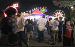 Residents of Lincoln Heights enjoying the fair. (by Braylin Collins, UT)